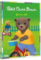 Petit ours brun fait du vélo |