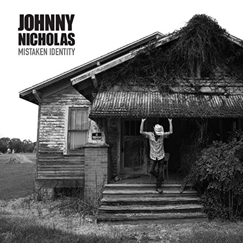 Mistaken Identity / Johnny Nicholas | Nicholas , Johnny . Chant. Guitare. Piano. Harmonica. Composition. Paroles